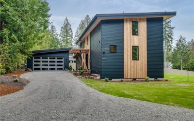 Two For One! This Bainbridge Island property has two modern homes for the price of one.